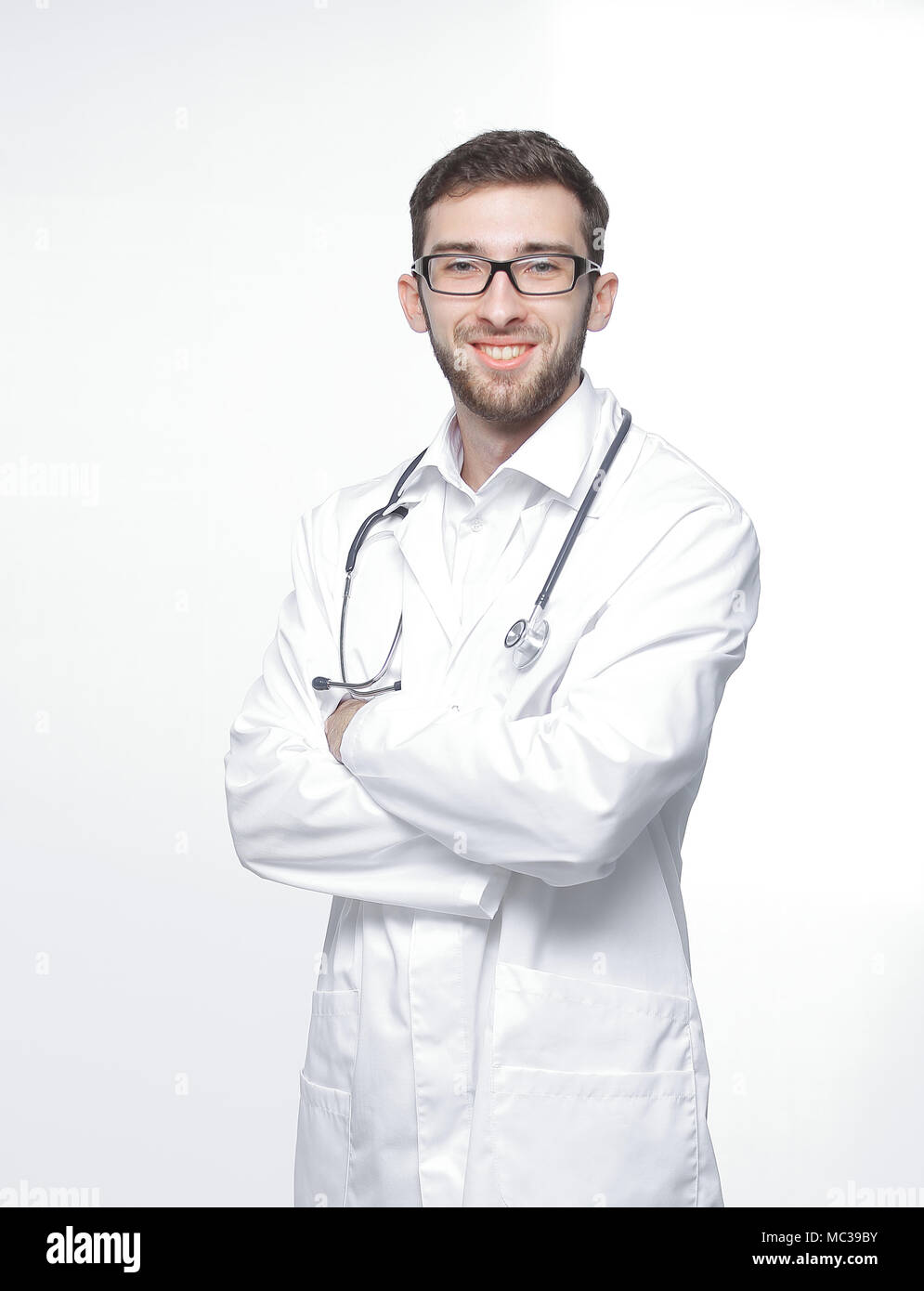 portrait of a confident doctor with a stethoscope.isolated on white - Stock Image