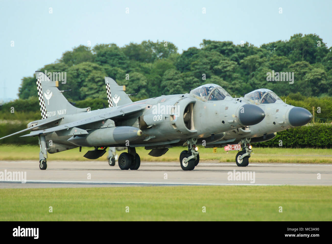 Royal Navy Fleet Air Arm BAe British Aerospace Sea Harrier F/A2 FRS2 pair vertical takeoff and landing jet fighter. Jump jet - Stock Image