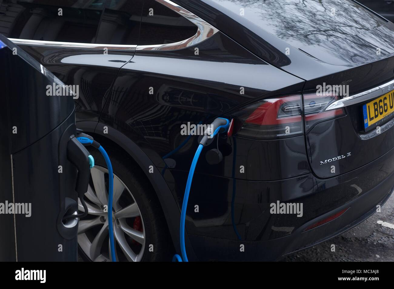 Hybrid, Electric Cars at charging point Stock Photo