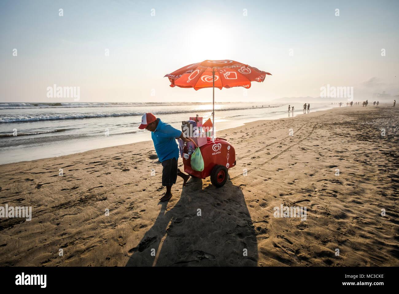 Man selling ice creams at the Acapulco Diamante Beach, Mexico Stock Photo