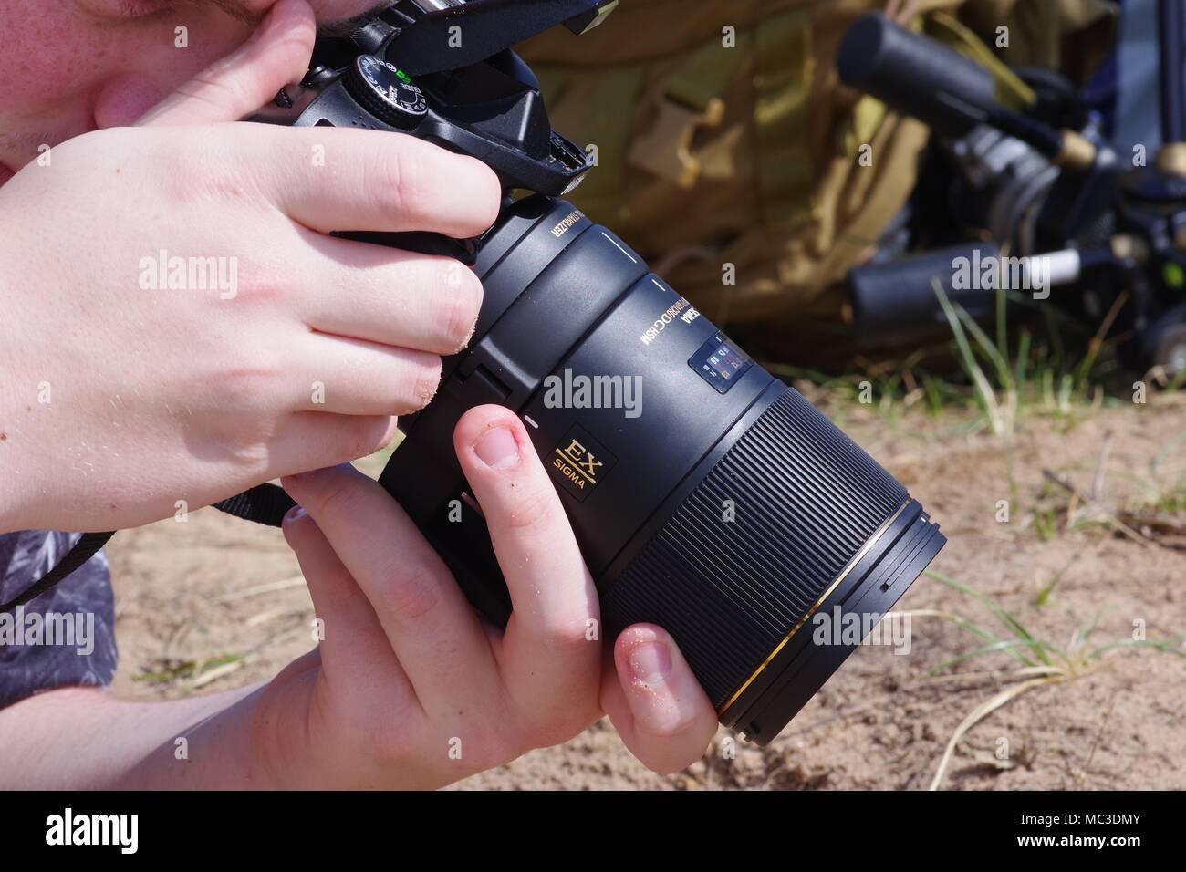 Entomologist doing Macro Nature Photography, with Nikon DSLR and Sigma Lens. Dawlish Warren, Devon, UK. Spring, 2018. - Stock Image