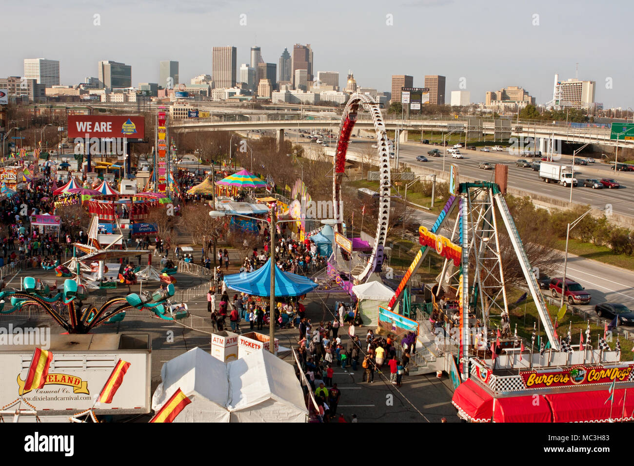 Atlanta, GA, USA - March 15, 2014:  Elevated wide shot of annual Atlanta Fair, with city skyline in background. - Stock Image