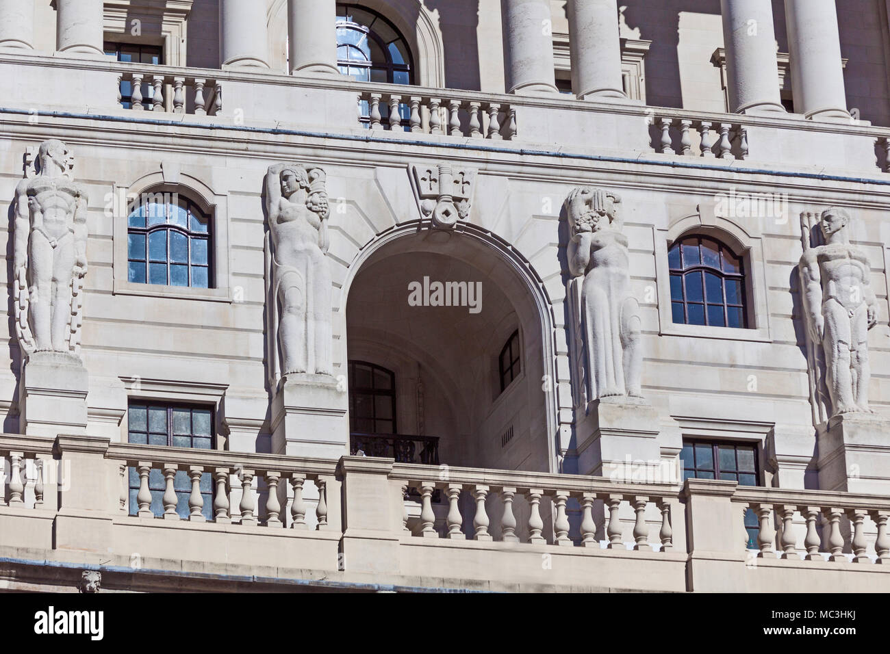 City of London.  Sculpted figures by Sir Charles Wheeler on the facade of the Bank of England in Threadneedle Street - Stock Image