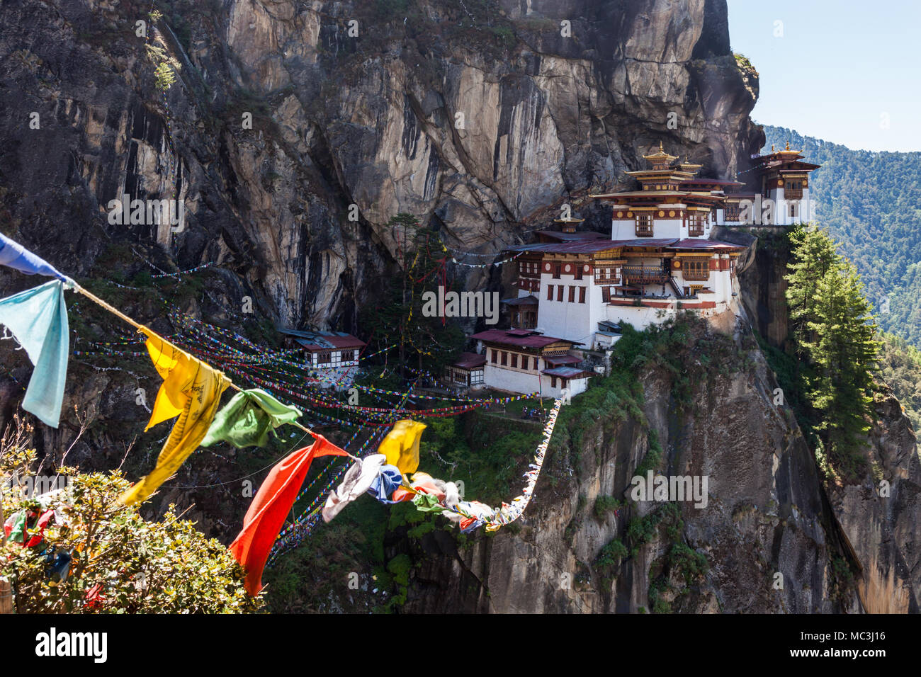 Paro Taktsang aka Tiger's nest is an old monastery situated on a cliff on a mountain at Paro, Bhutan - Stock Image