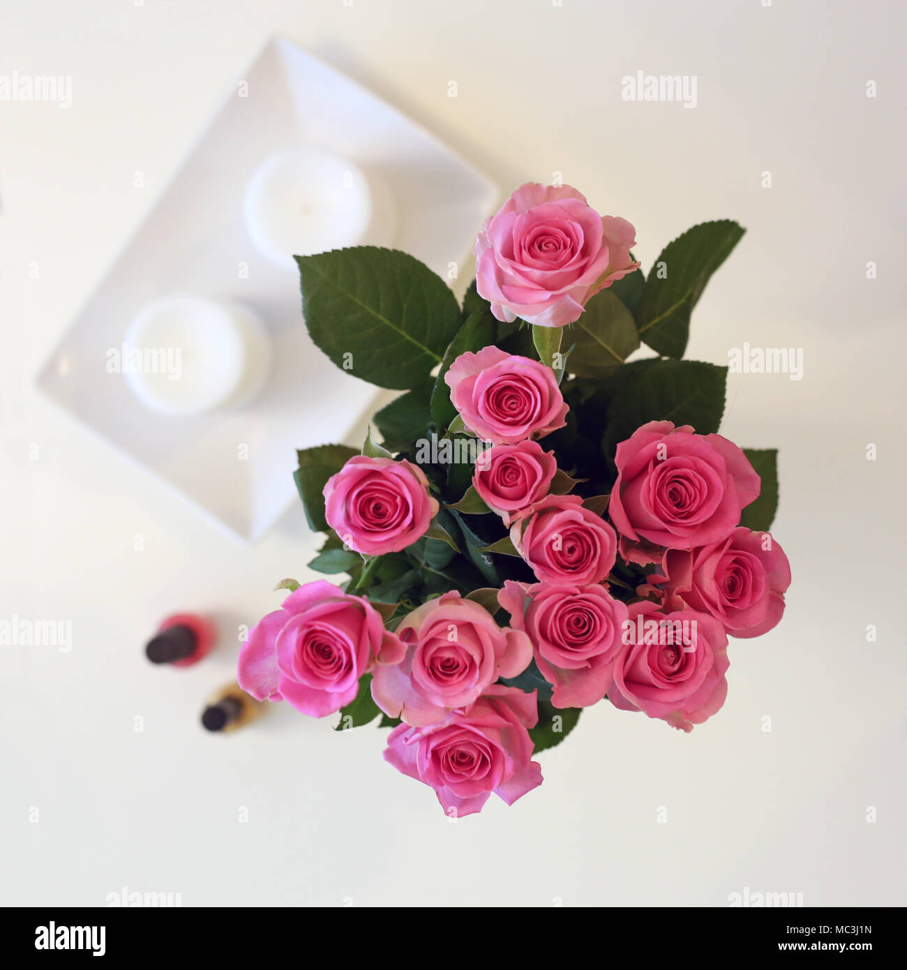 Bouquet pink roses candles on stock photos bouquet pink roses a bunch of pink flowers in a vase the photo is taken from above izmirmasajfo