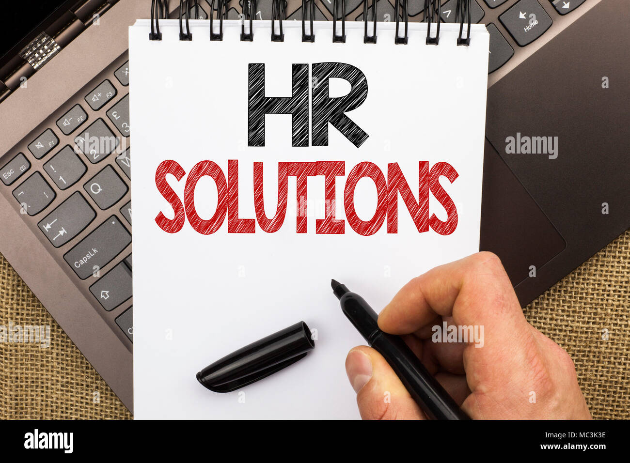 Word writing text Hr Solutions. Business concept for Recruitment Solution Consulting Management Solving Onboarding written by Man Holding Pen Notebook - Stock Image