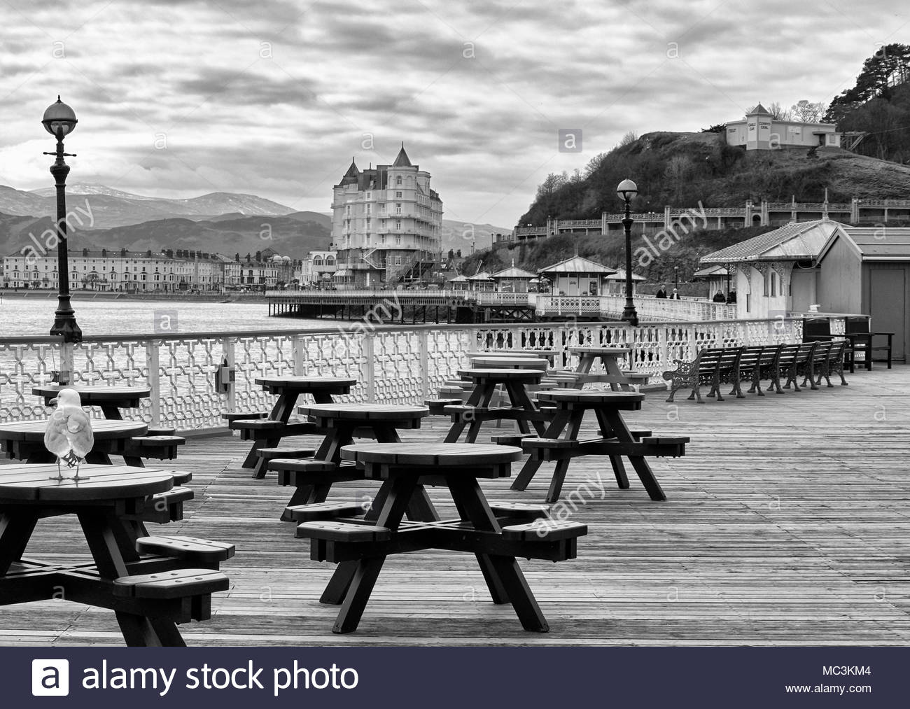 Empty tables in a cafe on llandudno pier in the welsh seaside resort in north wales uk - Stock Image