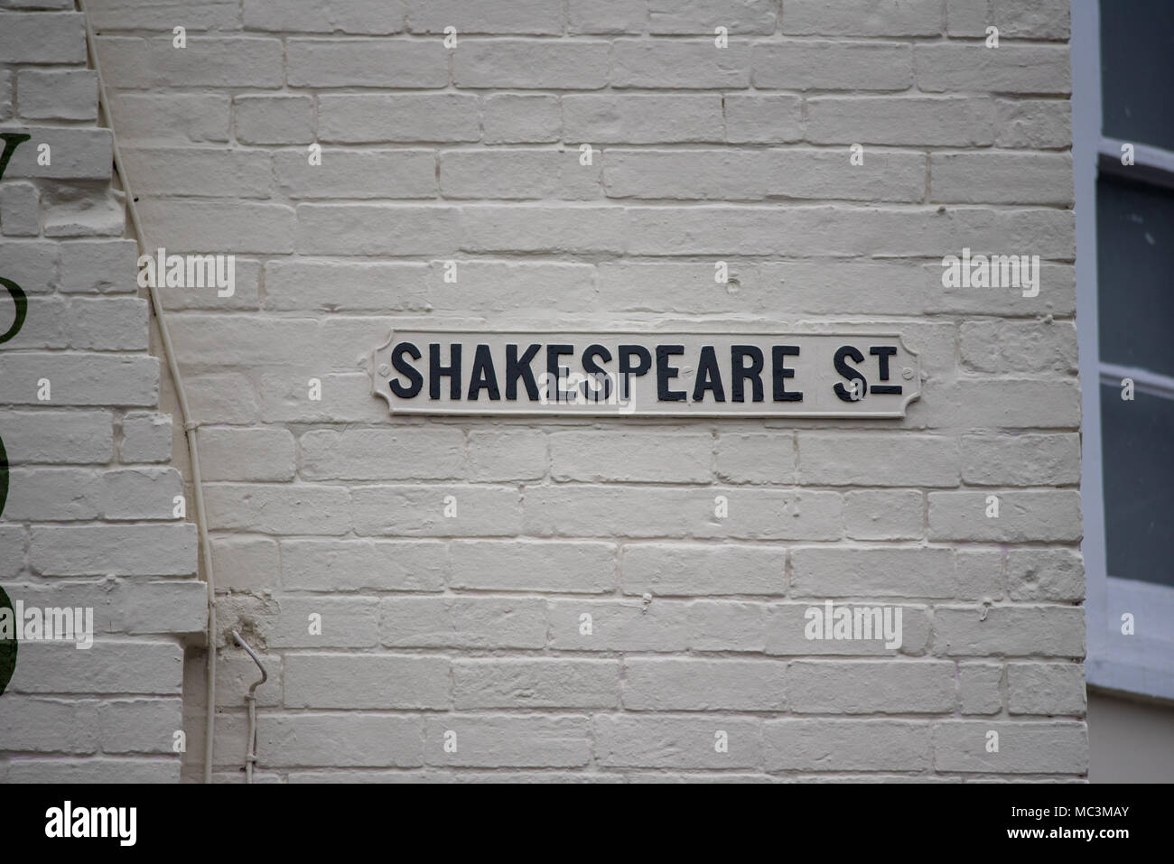 Shakesperare St sign on wall in Stret in Stratford upon Avon - Stock Image