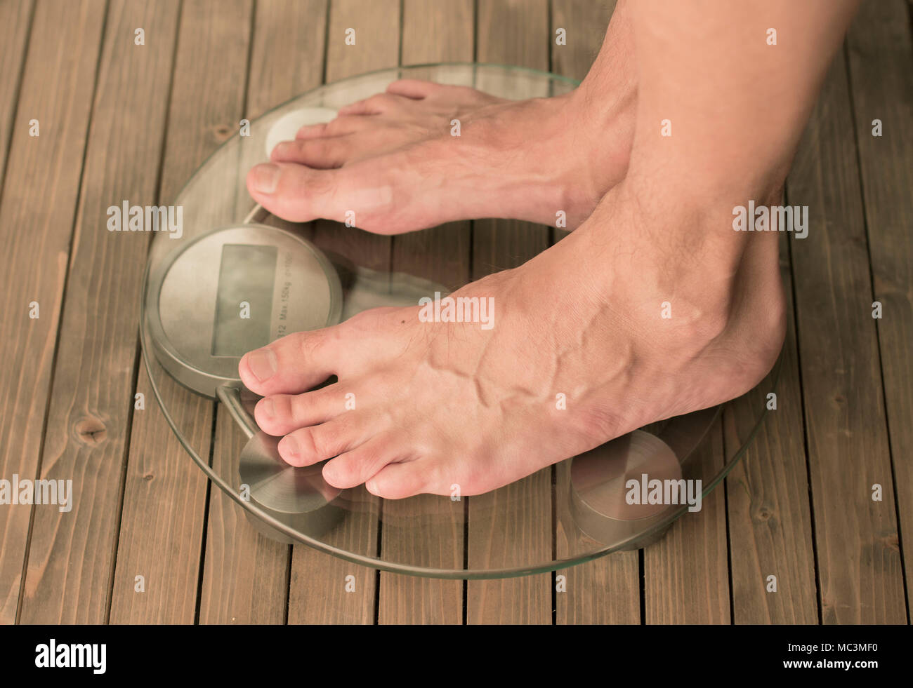 Man Stands On The Scales Male Feet On Glass Scales And Wooden Floor Stock Photo Alamy