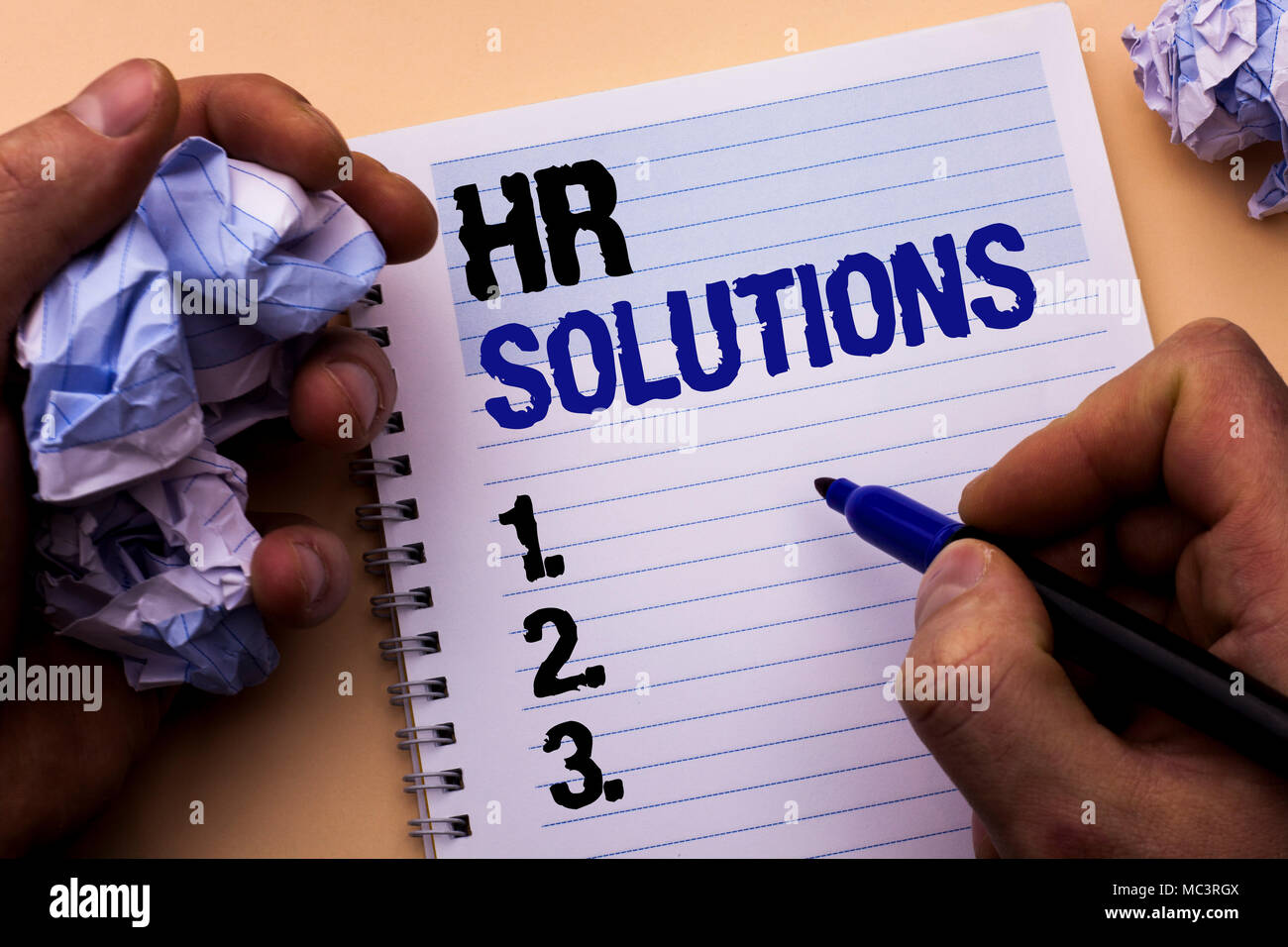 Handwriting text Hr Solutions. Concept meaning Recruitment Solution Consulting Management Solving Onboarding written by Man Notebook Book Holding Mark - Stock Image