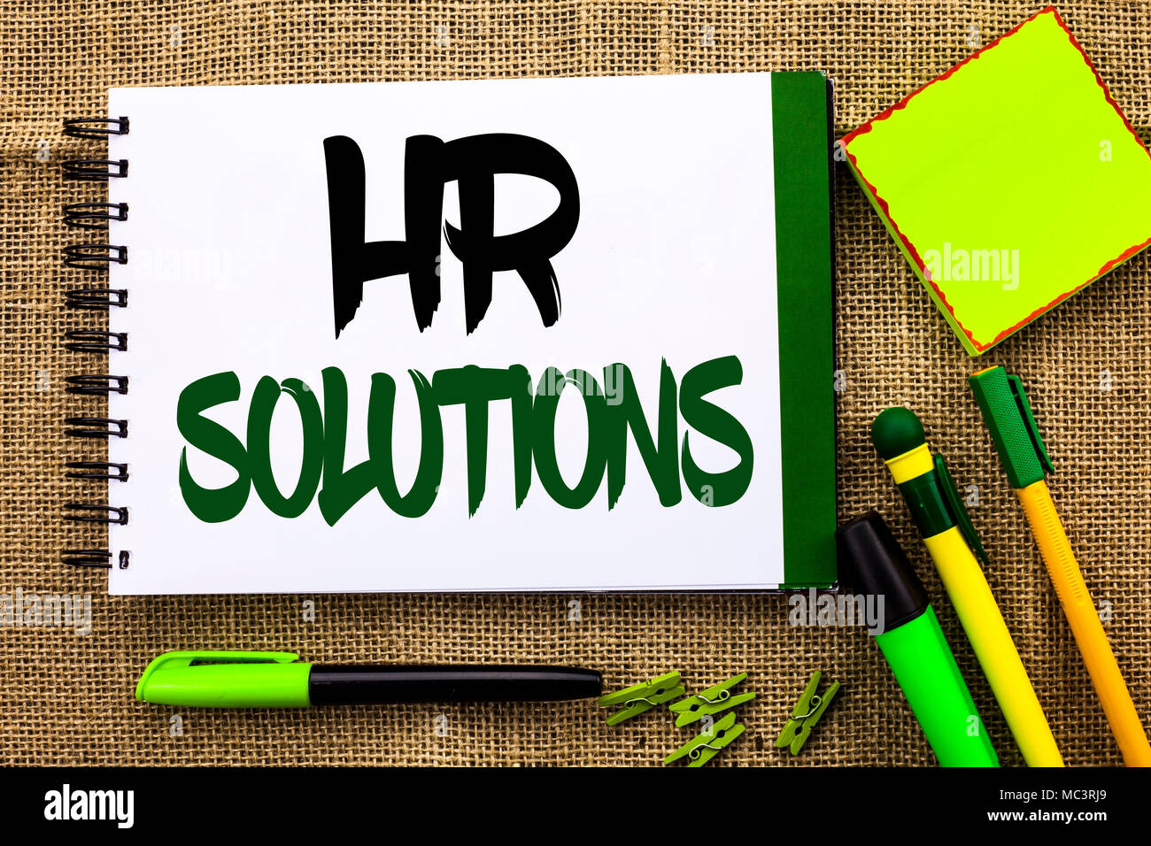Text sign showing Hr Solutions. Conceptual photo Recruitment Solution Consulting Management Solving Onboarding written Notebooke Book the jute backgro - Stock Image