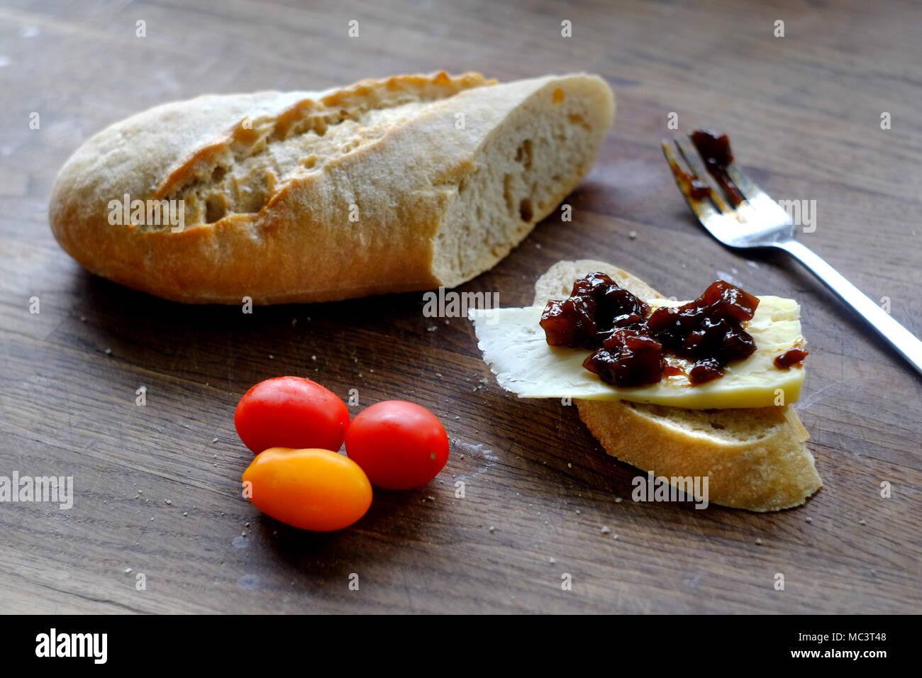 Cheese and pickle on rustic bread - Stock Image