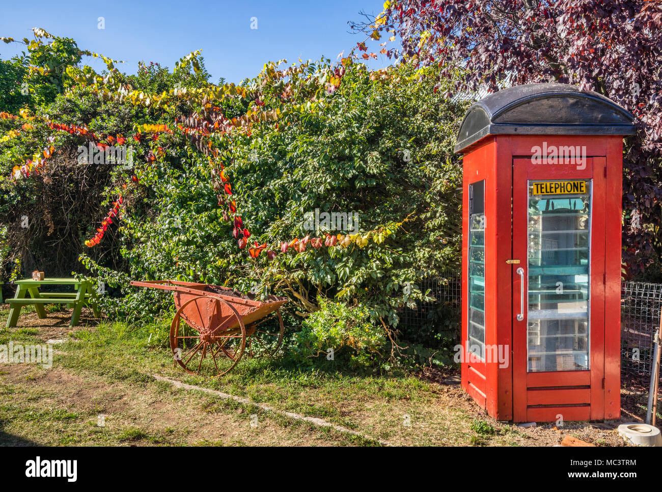 quaint telephone booth in an idyllic Millthorpe backyard, Central West New South Wales, Australia - Stock Image