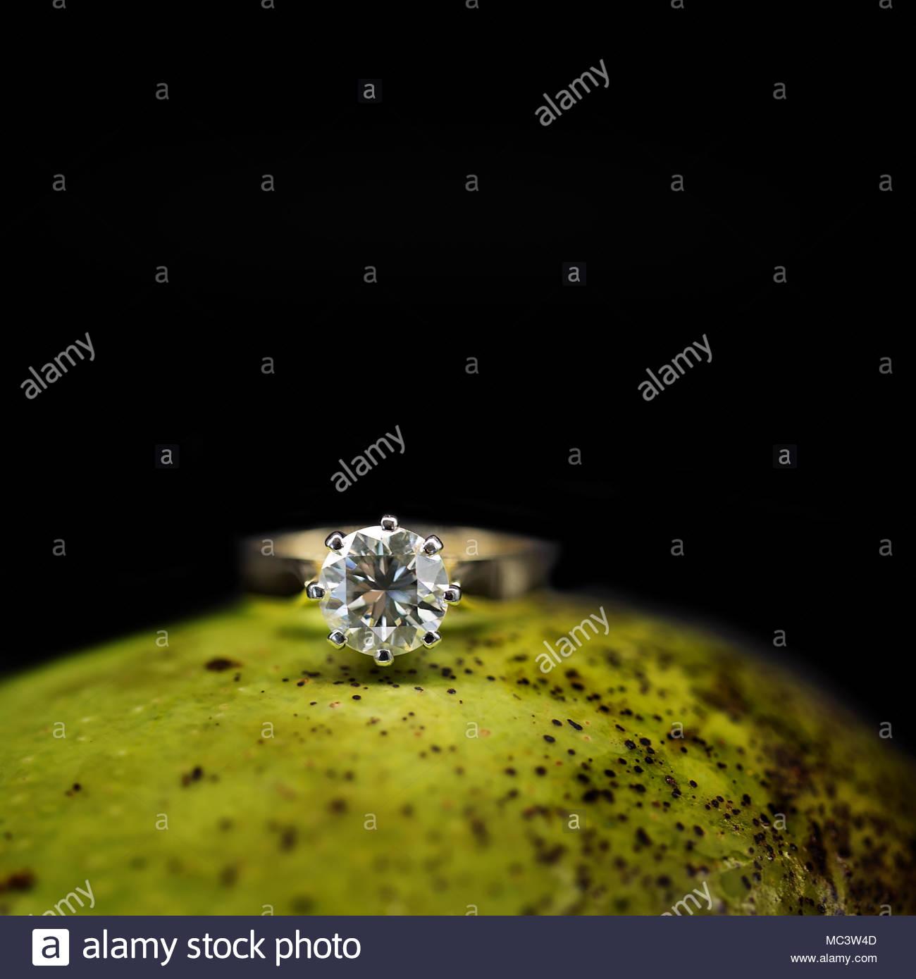 Large Claw Set Diamond Engagement Ring - Stock Image