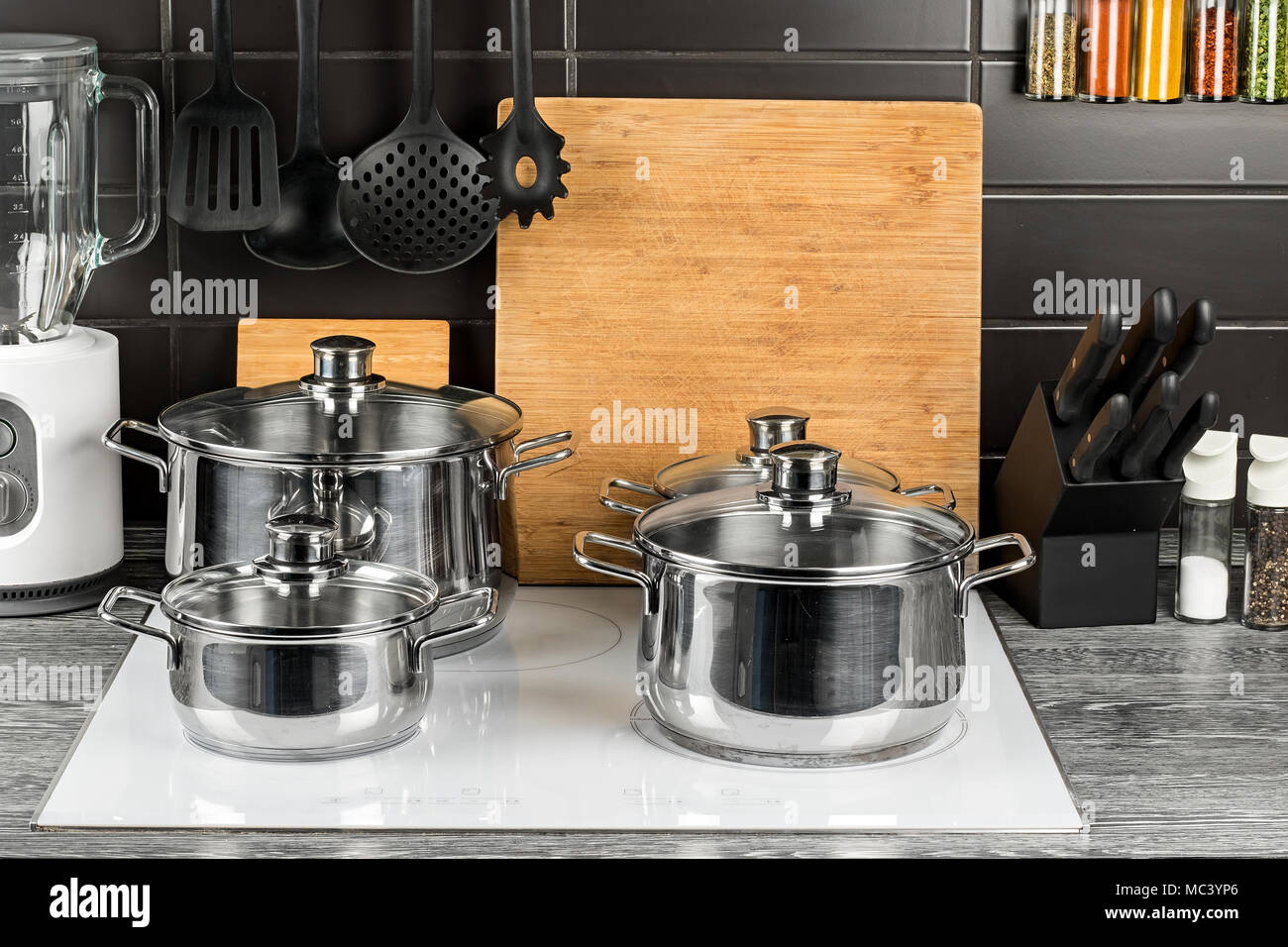 stainless steel cooking pots in kitchen on white induction hob food ...