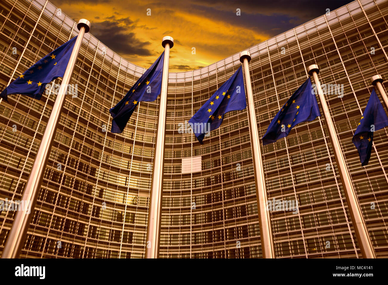 EU flags in front of European Commission building in Brussels - Stock Image