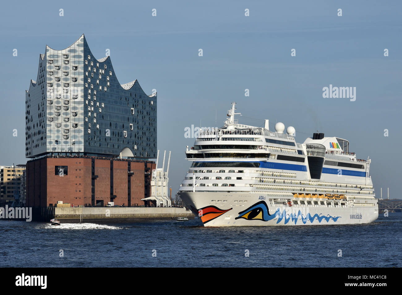 AIDAsol outbound from Hamburg passing the Elbphilharmonie concert hallStock Photo