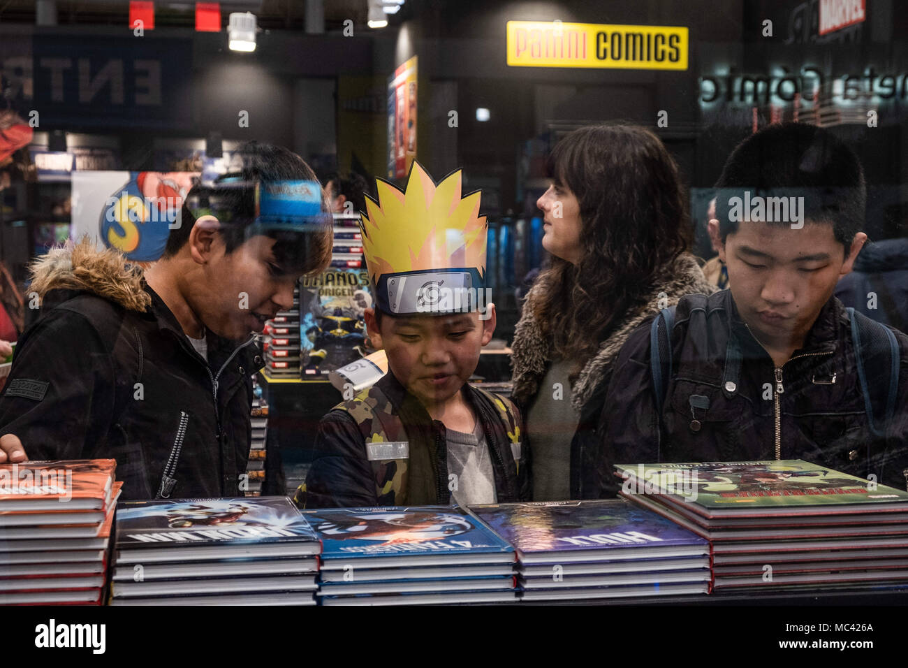 April 12, 2018 - Barcelona, Catalonia, Spain - Several children seen watching comics books. Opening of the 36th Barcelona International Comic Fair from 12th-15th April 2018 in Fira Barcelona Montjuïc. (Credit Image: © Paco Freire/SOPA Images via ZUMA Wire) Stock Photo