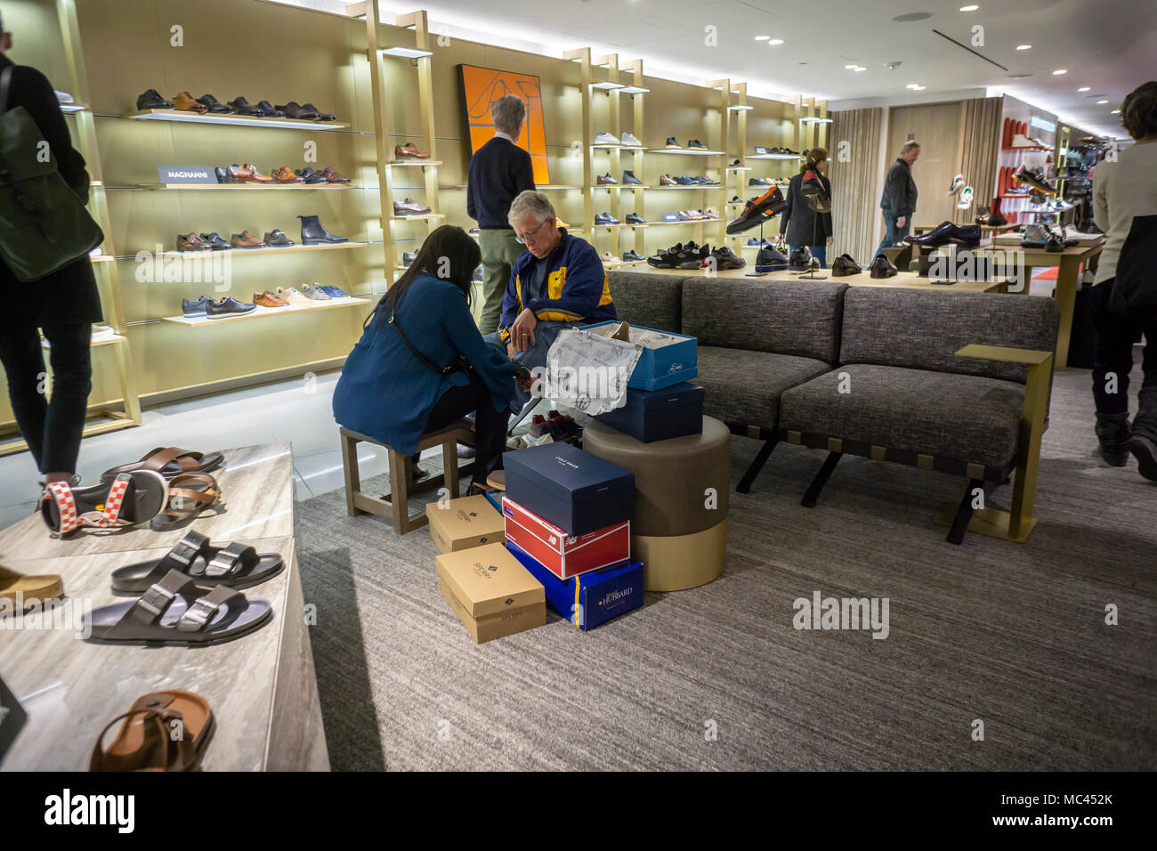 New York, USA. 12th Apr, 2018. Excited shoppers crowd the shoe department  in the new Nordstrom Men's Store in Midtown Manhattan in New York on its grand opening day, Thursday, April 12, 20187. The three-story 47,000 square feet store is directly across from the future women's store opening in 2019. The store is Nordstrom's first-ever New York store although it already has two Nordstrom Rack off-price stores. Credit: Richard Levine/Alamy Live News - Stock Image