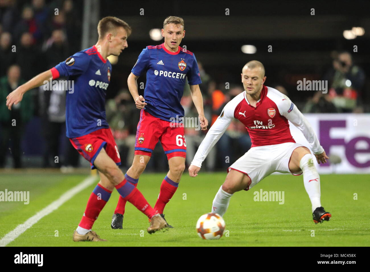 Moscow, Russia. 12th Apr, 2018. MOSCOW, RUSSIA - APRIL 12, 2018: CSKA Moscow's Konstantin Kuchayev, Fyodor Chalov and Arsenal F.C.'s Jack Wilshere (L-R) fight for the ball in their 2017-2018 UEFA Europa League quarterfinal second leg football match at VEB Arena (Arena CSKA). Sergei Bobylev/TASS Credit: ITAR-TASS News Agency/Alamy Live News - Stock Image