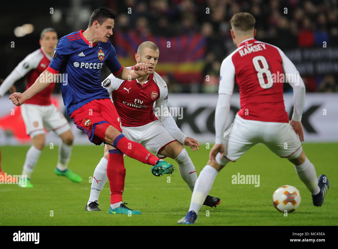 Moscow, Russia. 12th Apr, 2018. MOSCOW, RUSSIA - APRIL 12, 2018: CSKA Moscow's Kristijan Bistrovic and Arsenal F.C.'s Jack Wilshere, Aaron Ramsey (L-R) in action in their 2017-2018 UEFA Europa League quarterfinal second leg football match at VEB Arena (Arena CSKA). Sergei Bobylev/TASS Credit: ITAR-TASS News Agency/Alamy Live News - Stock Image