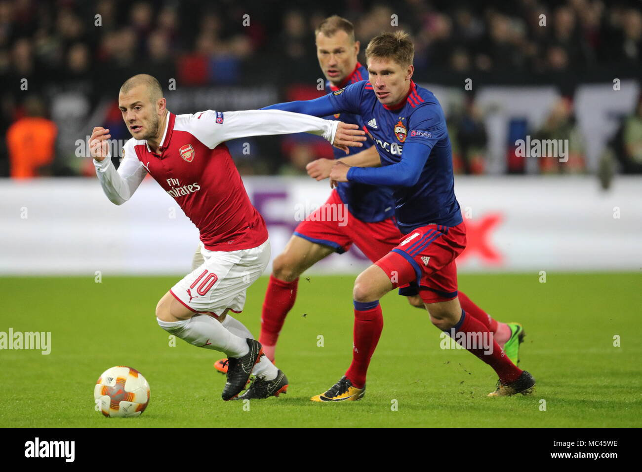 Moscow, Russia. 12th Apr, 2018. MOSCOW, RUSSIA - APRIL 12, 2018: Arsenal F.C.'s Jack Wilshere (L) and CSKA Moscow's Kirill Nababkin fight for the ball in their 2017-2018 UEFA Europa League quarterfinal second leg football match at VEB Arena (Arena CSKA). Sergei Bobylev/TASS Credit: ITAR-TASS News Agency/Alamy Live News - Stock Image