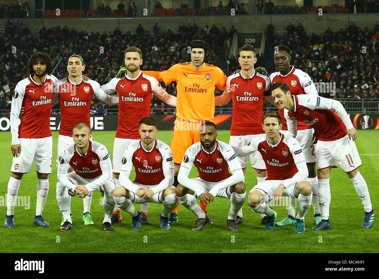 Moscow, Russia. 12th Apr, 2018. MOSCOW, RUSSIA - APRIL 12, 2018: Arsenal F.C.'s Jack Wilshere, Aaron Ramsey, Alexandre Lacazette, Nacho Monreal, Mesut Ozil (L-R front), Mohamed Elneny, Hector Bellerin, Shkodran Mustafi, goalkeeper Petr Cech, Laurent Koscielny and Danny Welbeck (L-R background) pose for a group photograph ahead of the 2017-2018 UEFA Europa League quarterfinal second leg football match against CSKA Moscow at VEB Arena (Arena CSKA). The game ended in a 2-2 draw. Mikhail Tereshchenko/TASS Credit: ITAR-TASS News Agency/Alamy Live News - Stock Image