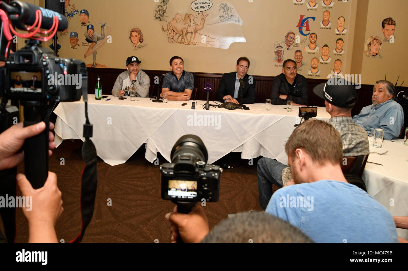 4-12-18. Los Angeles, CA. (L-R) Gennady (GGG) Golovkin, promoter Tom Loeffler and trainer Abel Sanchez, held a press conference in Los Angeles Thursday with the unified middleweight titleholder present, and he announced -- absolutely nothing.Nothing is finalized for a May 5 fight. But, it appears the WBC, and the WBA changed their minds about former 154-pound world title contender Vanes Martirosyan.In a conference call Tuesday morning, officials with the IBF, WBC, and WBA, turned down the Martirosyan fight. The Team is waiting for the Las Vegas boxing commission to make their final dec - Stock Image