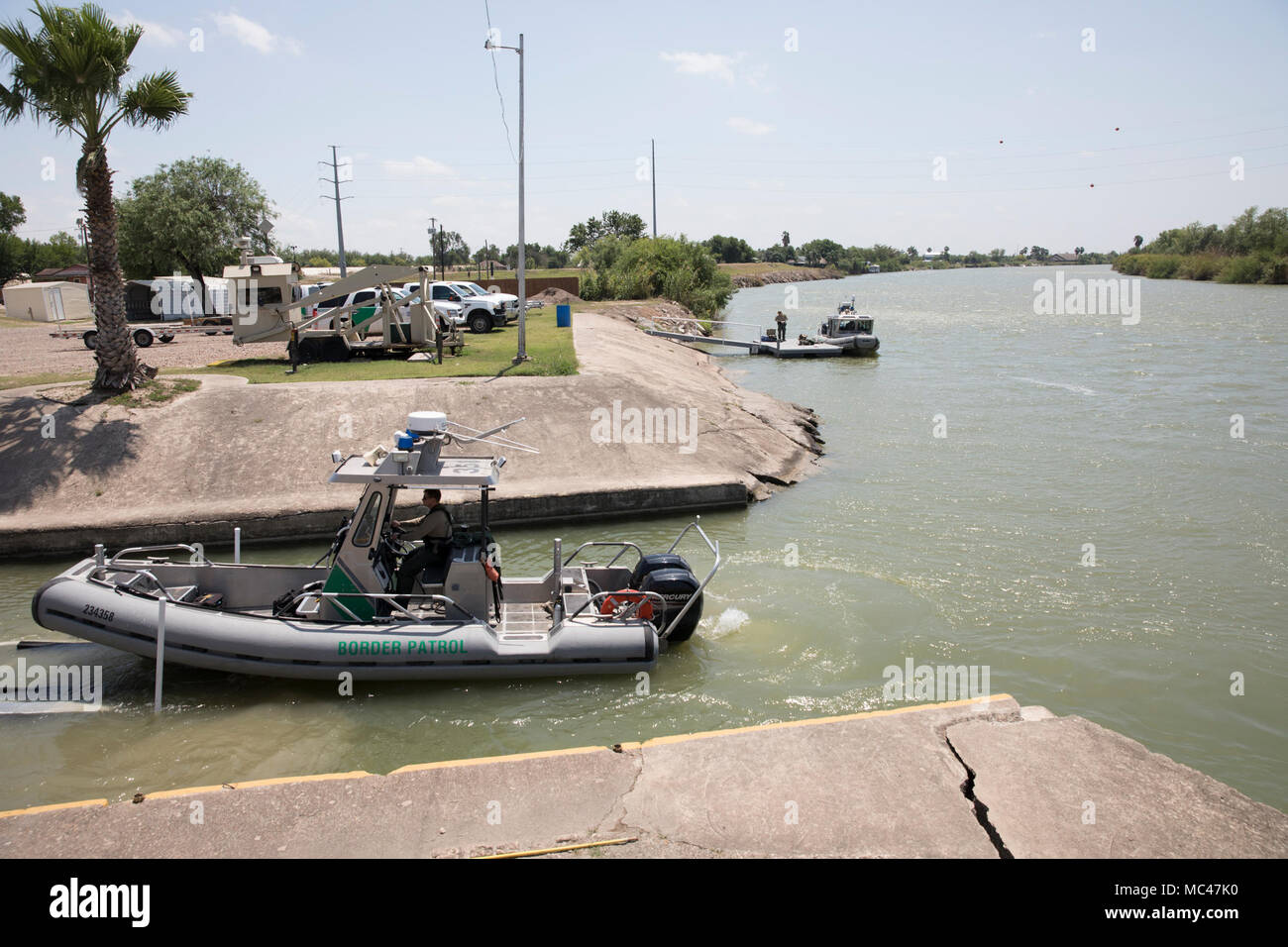 The U.S. Border Patrol works boats on the Rio Grande River south of McAllen, TX at Anzalduas Park on the U.S.-Mexico border. An uptick in illegal crossings has occurred the past three months. Stock Photo