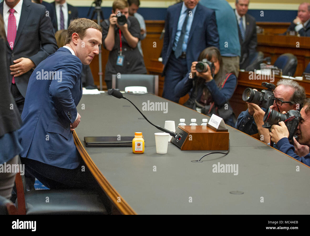 Mark Zuckerberg Co Founder And Ceo Of Facebook Returns To His Seat To Resume His Testimony Before A Meeting Of The United States House Committee On Energy And Commerce During A Hearing On
