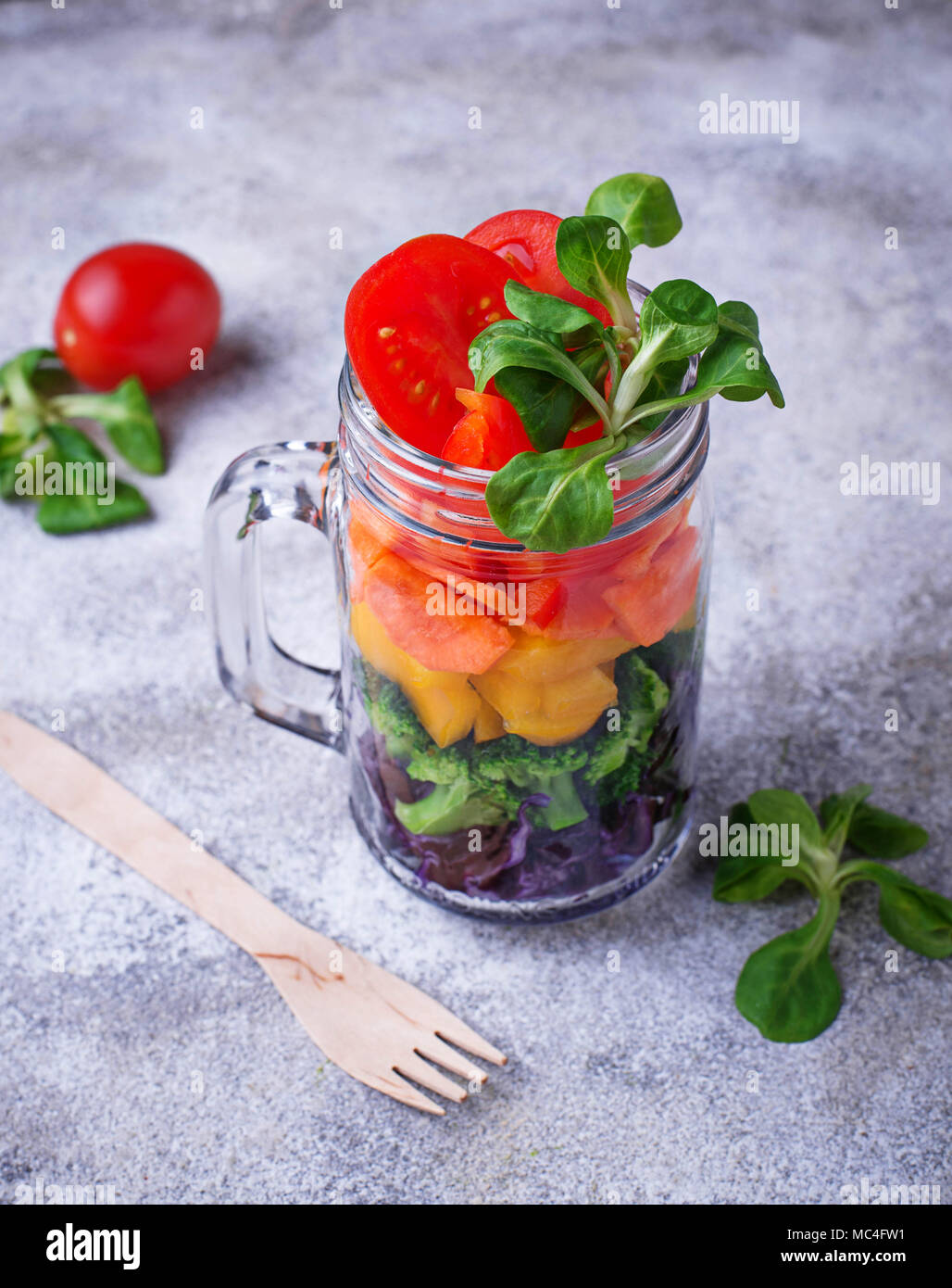 Vegetarian rainbow salad in a glass jar - Stock Image