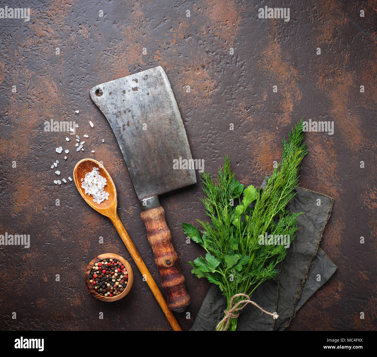 Butchers vintage cleaver with spices  - Stock Image