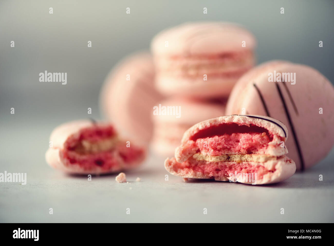 Pink french macaroons. Pastel colors macarons with copy space, top view. Holidays and celebrations concept. Sweet gift for woman, girl - Stock Image