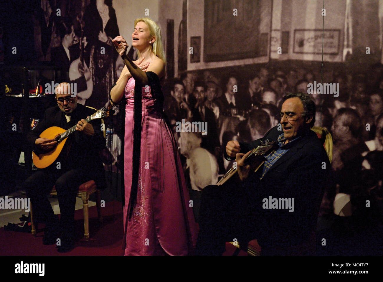 Female singer and guitar players during live Fado Show 'Fado com Historia' in Tavira - Stock Image