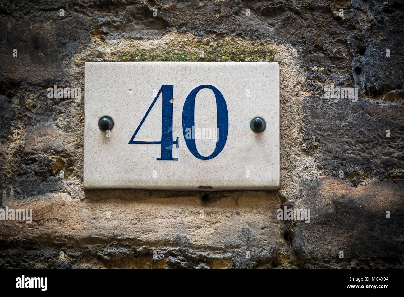 Number forty door number on brick wall - Stock Image