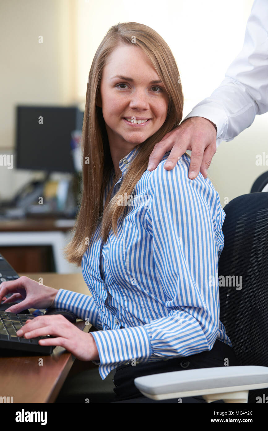 Businessman And Businesswoman Having Affair In Office - Stock Image