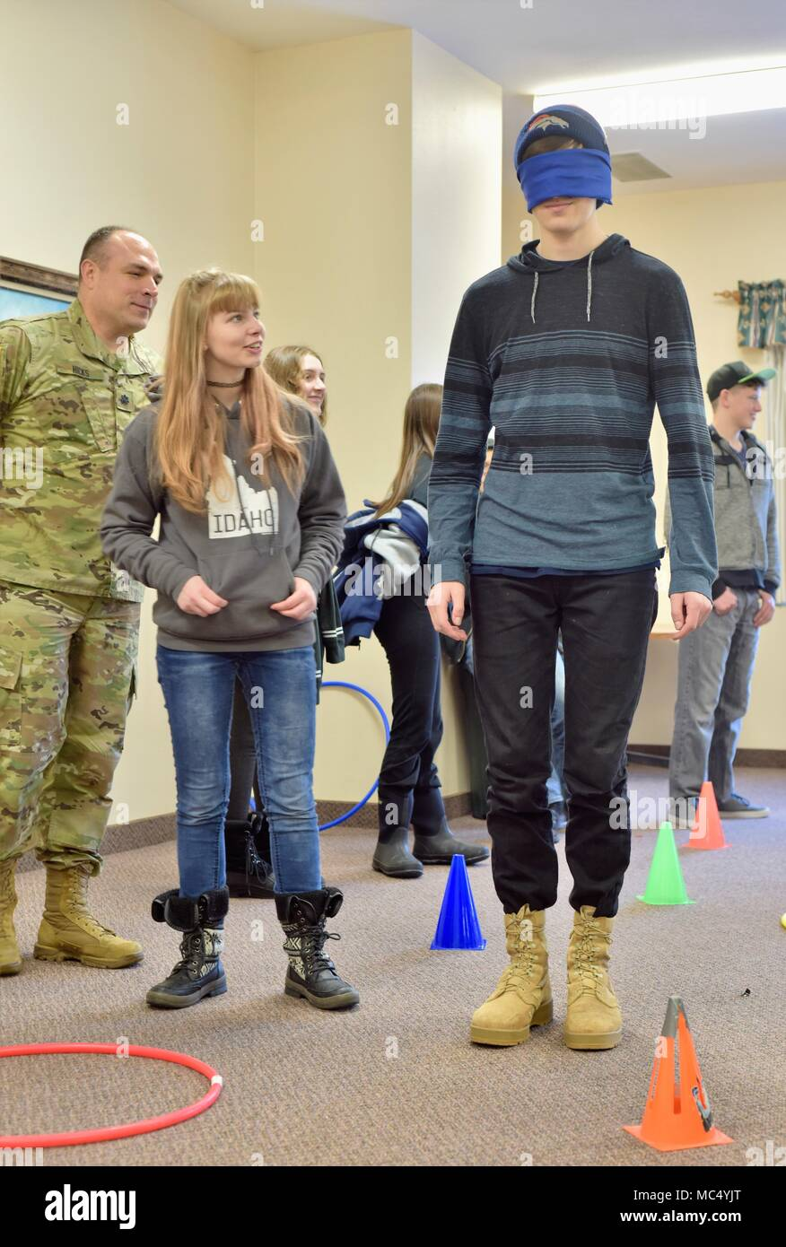 Sara Darney leads Skyler Rash through an obstacle course during the Idaho National Guard Child and Youth Services' Snow Bash event mid-January. The course teaches military children that they aren't alone and to trust each other. - Stock Image
