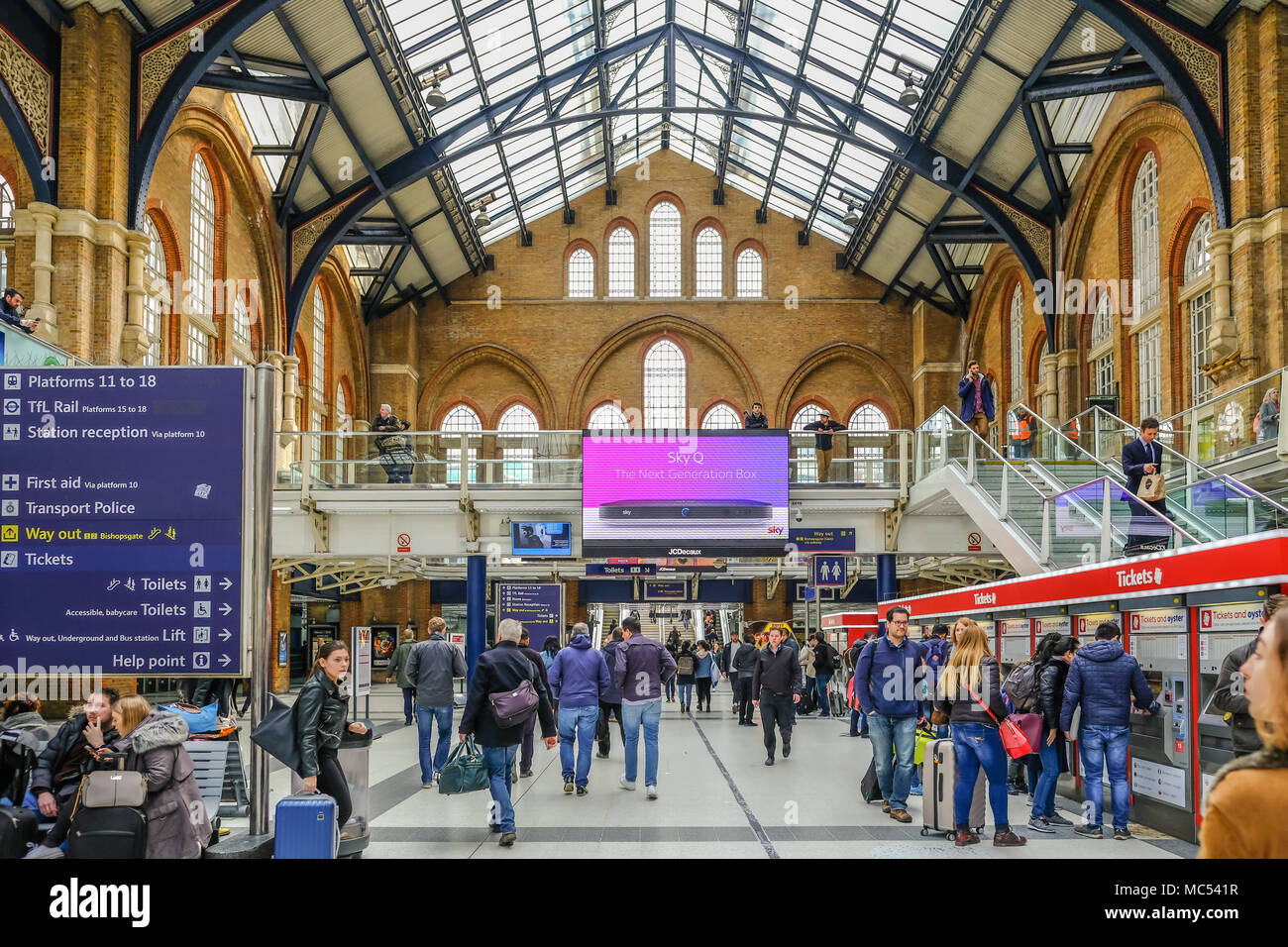 Liverpool Street, London, UK - April 6, 2018: Wide angle shot of mainline station with lots of passengers. - Stock Image