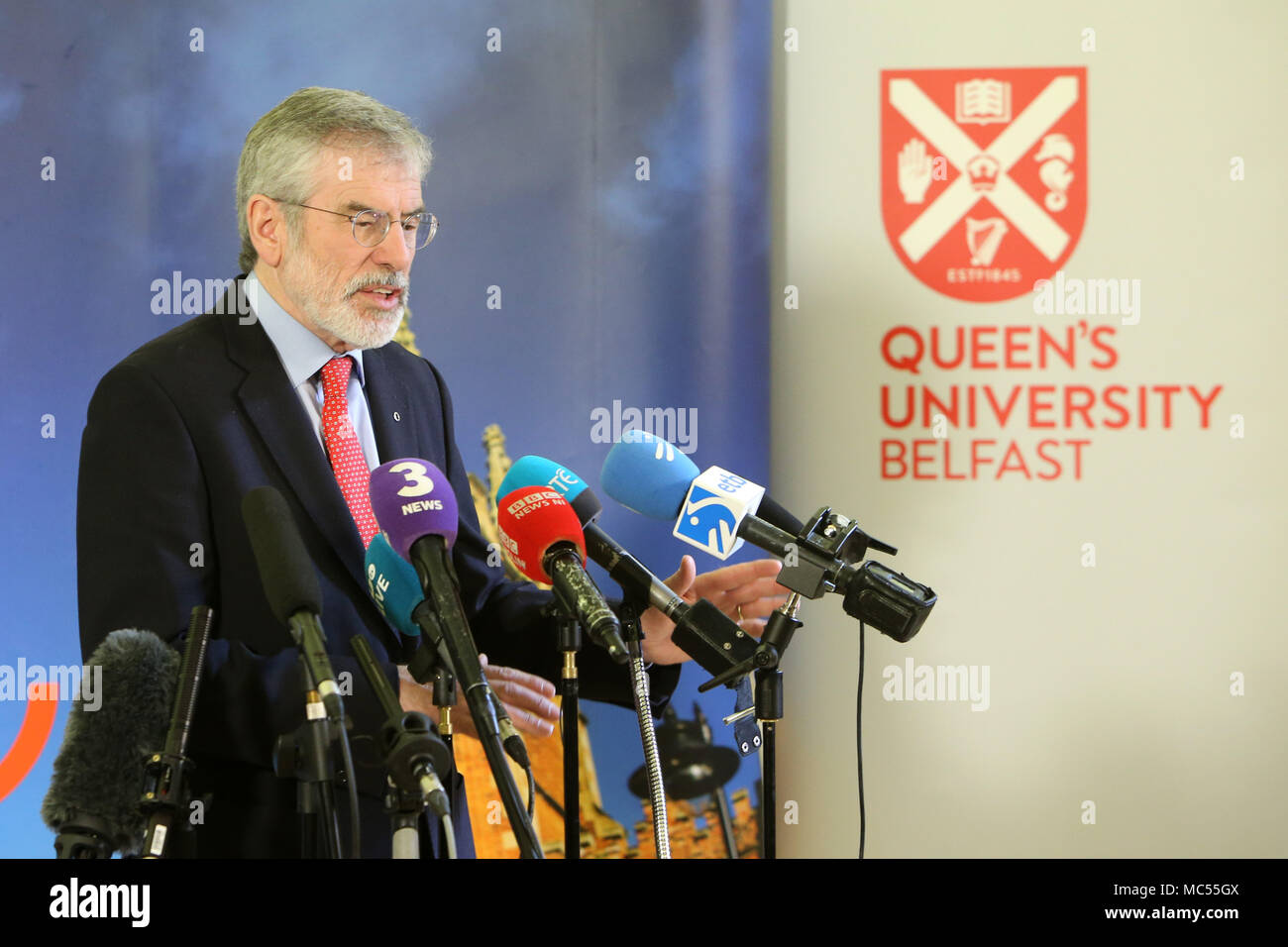 Gerry Adams, former Sinn Fein Leader speaks during a press conference  at  Queen's University Belfast, Tuesday, April 10th, 2018. Tuesday marks 20 years since politicians from Northern Ireland and the British and Irish governments agreed what became known as the Good Friday Agreement. It was the culmination of a peace process which sought to end 30 years of the Troubles. Two decades on, the Northern Ireland Assembly is suspended in a bitter atmosphere between the two main parties. - Stock Image