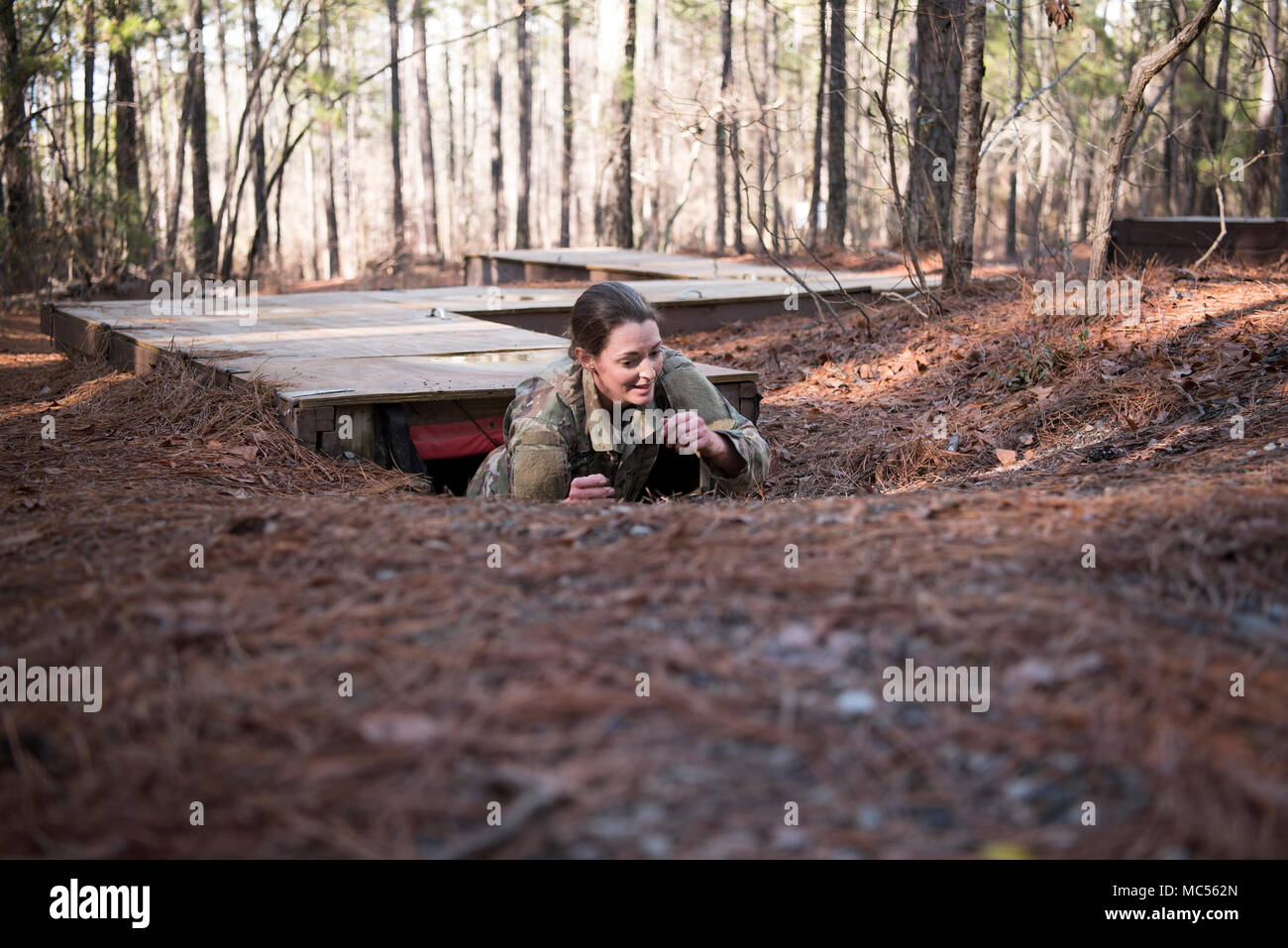 Spc. Michelle Green, combat medic, Medical Command, South Carolina Army National Guard, crawls out of an obstacle during the South Carolina Army National Guard Best Warrior competition at the Fit to Win obstacle course, Fort Jackson, South Carolina, Jan. 29. Green, a native of Summerville, South Carolina, has been a member of the South Carolina Army National Guard for 18 months and was the only female competitor this year. (U.S. Army photo by Staff Sgt. Jerry Boffen, 108th Public Affairs Detachment) Stock Photo