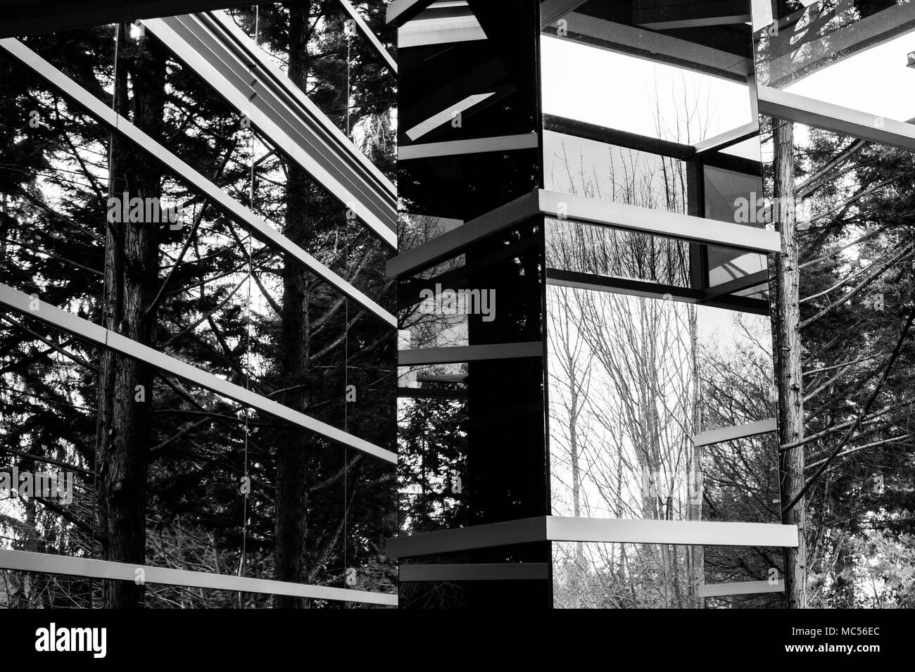 Abstract image of office building with window reflections of trees and unusual architecture design Stock Photo