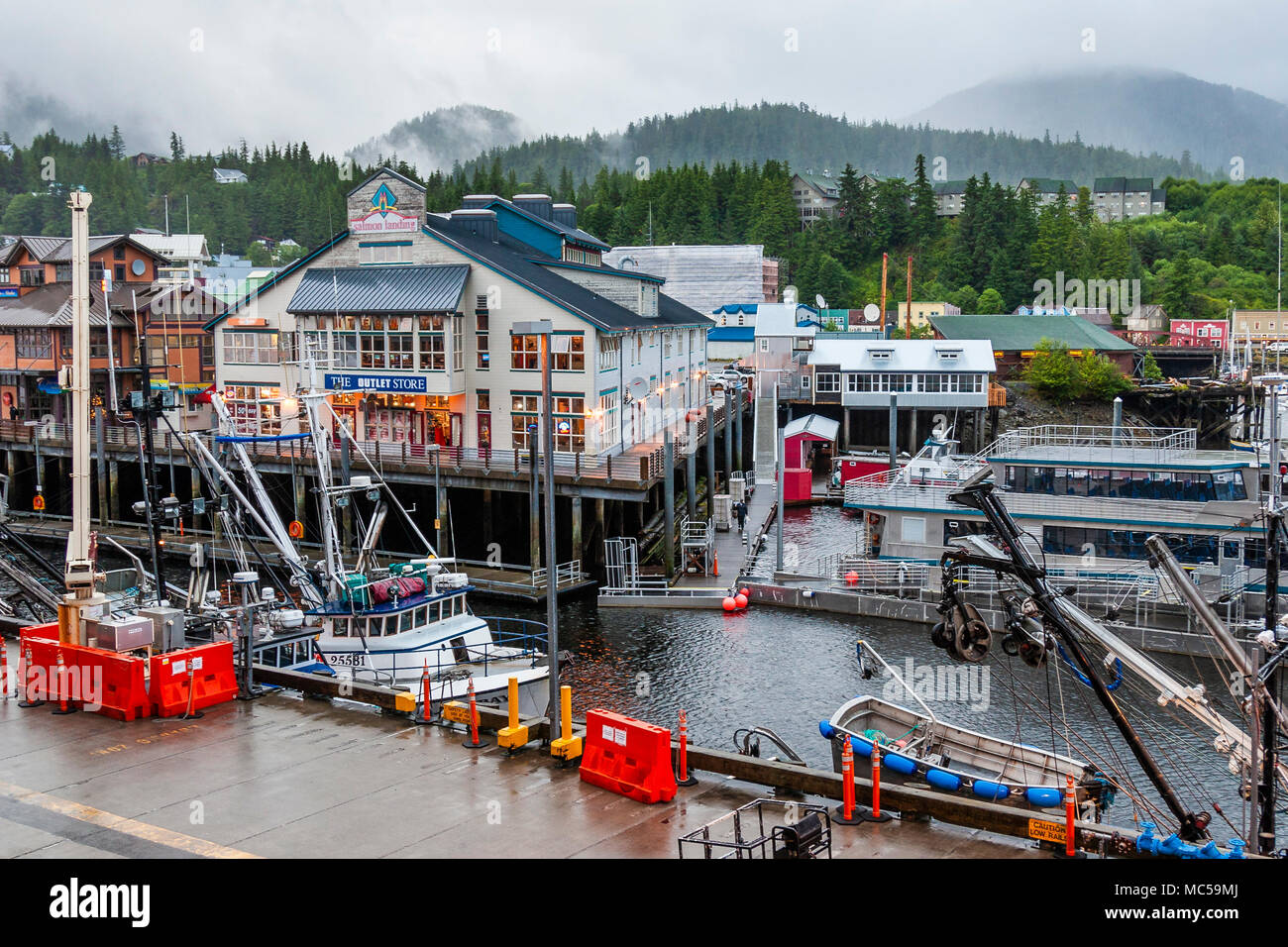 Tourism and Fishing boats at Ketchican, Alaska, port of call for Alaska cruise ships following the Inside Passage route. - Stock Image