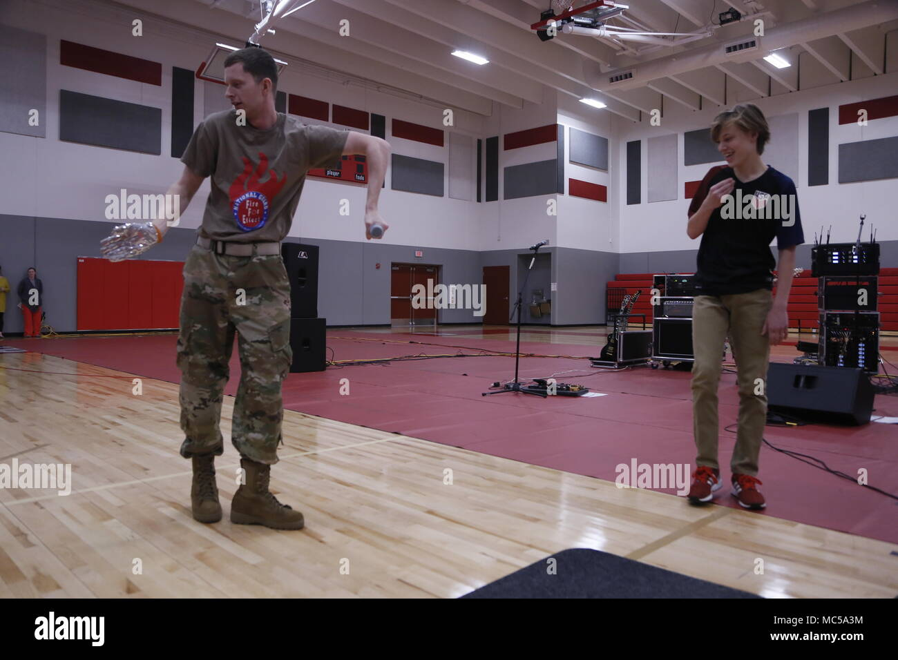 SPC Zach Nickerson performs Michael Jackson's 'Billie Jean' with the help of a Mexico Junior High School student in Mexico, MO January 25, 2018. This was Nickerson's first tour with the band. - Stock Image