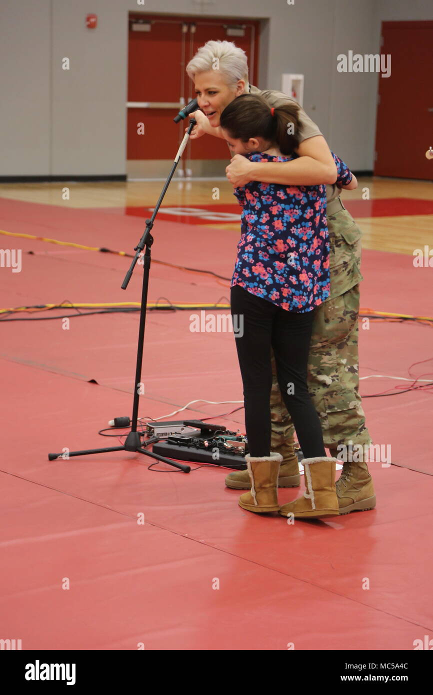 SGT Christiana Ball of Fire For Effect hugs a Mexico Junior High School student after the performance at the school on January 25, 2018. - Stock Image