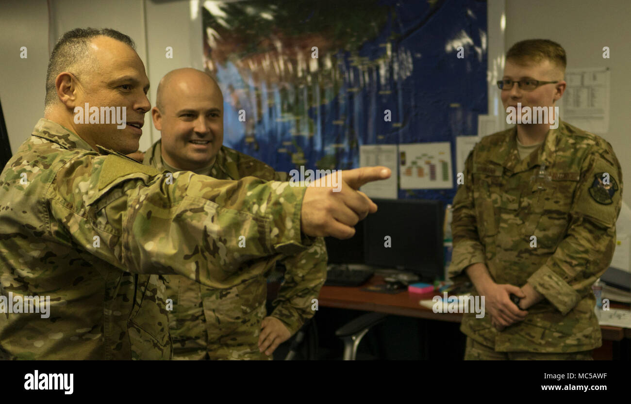 U.S. Air Force Chief Master Sgt. Matthew Caruso, command senior enlisted leader of U.S. Transportation Command, engages with Airmen from the 353rd Special Operations Group during a tour Jan. 26, 2017, at Kadena Air Base, Japan. Caruso toured facilities and interacted with Airmen during his 2-day visit to the Pacific. (U.S. Air Force photo by Capt. Jessica Tait) Stock Photo