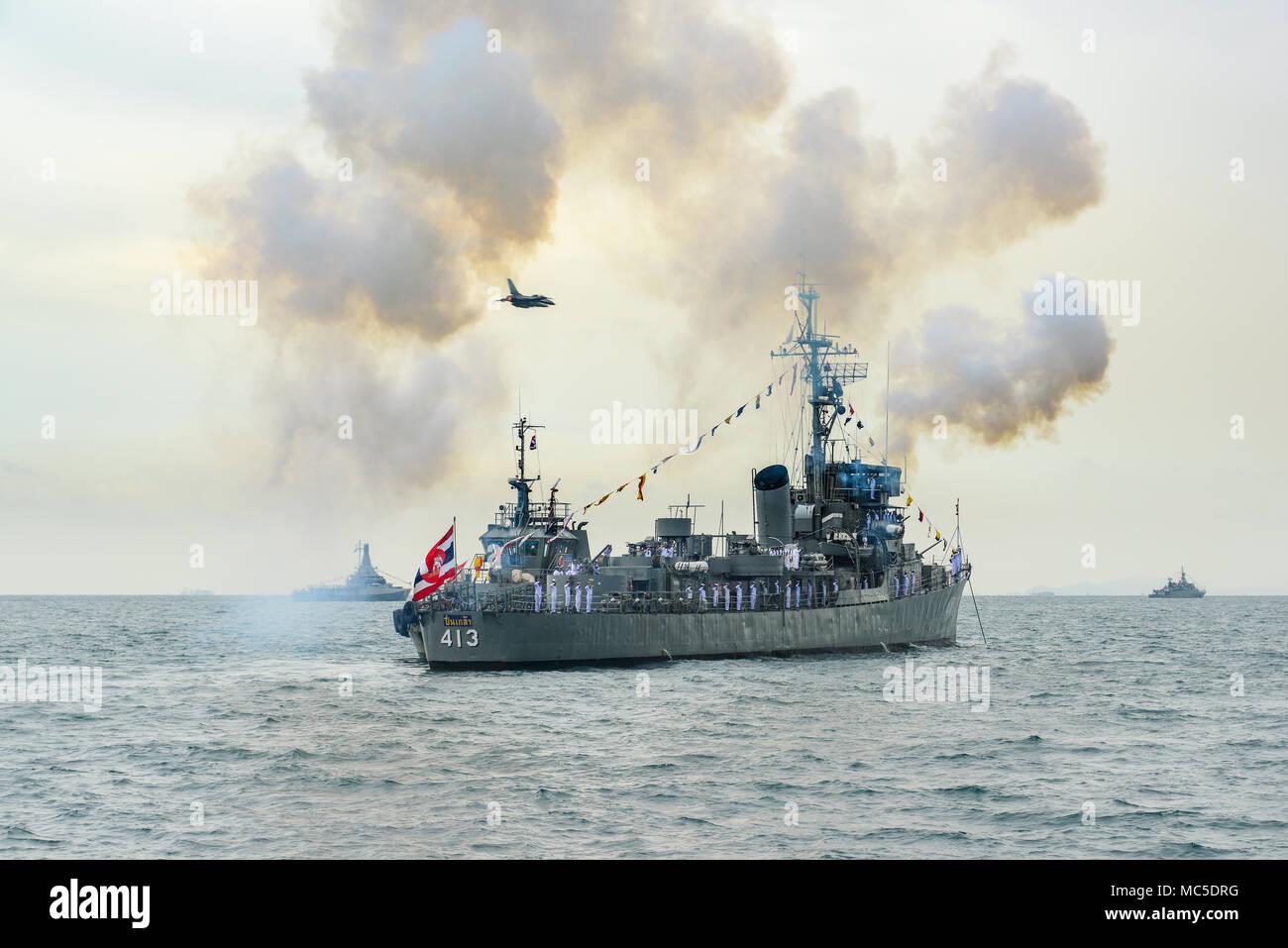 Pattaya, Thailand - November 20, 2017, Navy warship gunning salute on sea whle warplane above the ship on the 50th anniversary ASEAN international fle - Stock Image