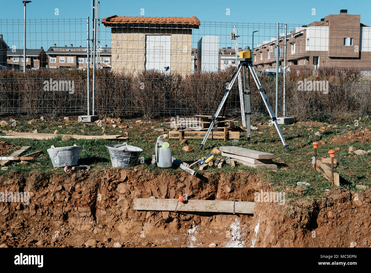 Topographical instruments on dirty construction site - Stock Image