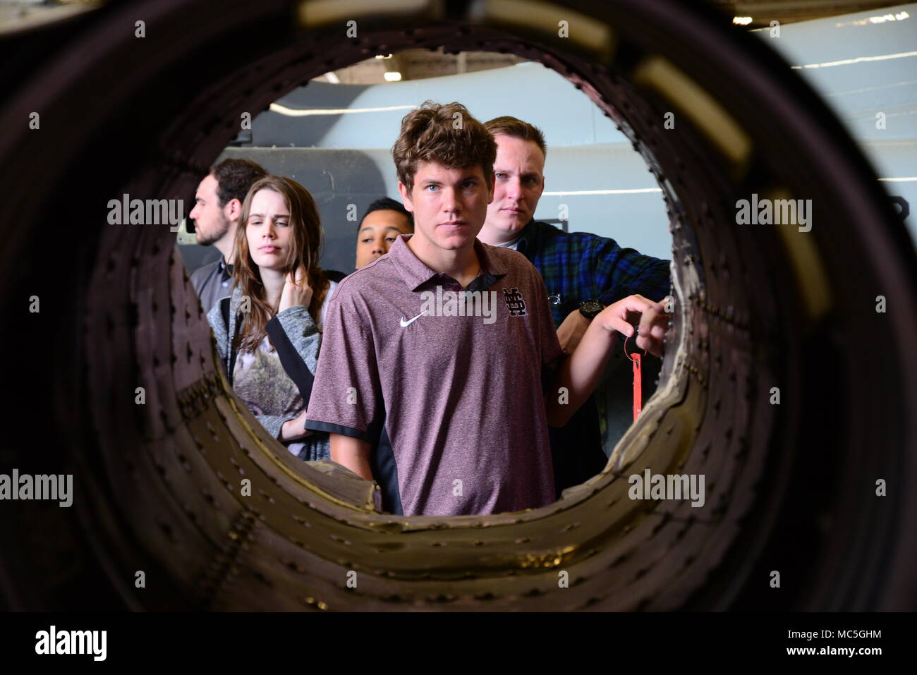 David Mongeau, a Mississippi State University Aircraft Propulsion student, examines the shell of a T-38C Talon engine April 4, 2018, on Columbus Air Force Base, Mississippi. An aerospace engineering student will spend over 1,000 hours in their classroom learning the different components of aircraft. (U.S. Air Force photo by Airman 1st Class Beaux Hebert) - Stock Image