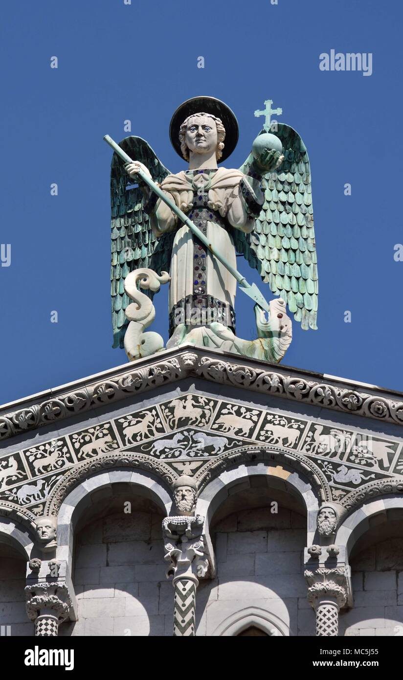 Close up of the statue of St Michele of the 13th century Romanesque facade of the San Michele in Foro, Lucca, Tuscany, Italy, Italy, Italian. - Stock Image