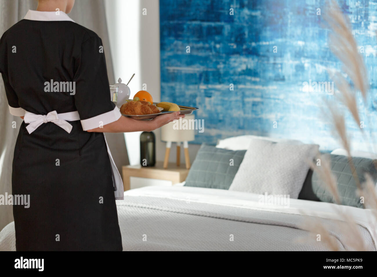 Breakfast delivering service in a modern hotel Stock Photo